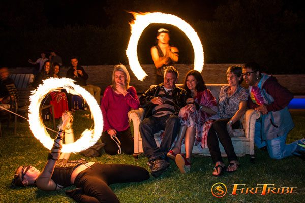 Guests pose with fire dancers at a private birthday party in cape town