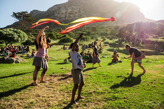 Spinning poi with firetribe at the muizenberg festival is something to do in cape town