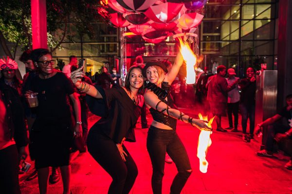 a johannesburg fire dancing performer is entertainment for guests at a function hosted by ABSA