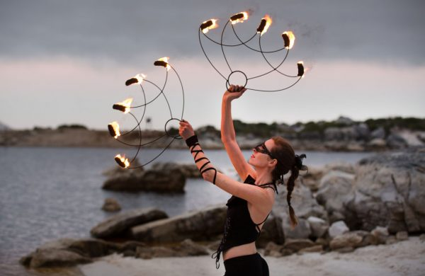 Caitlin Leigh dances with protea fire fans made by firetribe