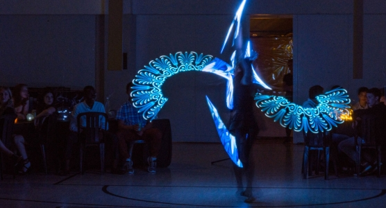 Beautiful dancer with LED poi is custom performance art for school fuction