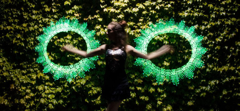 amazing ornamental led lights shine green against a leafy background