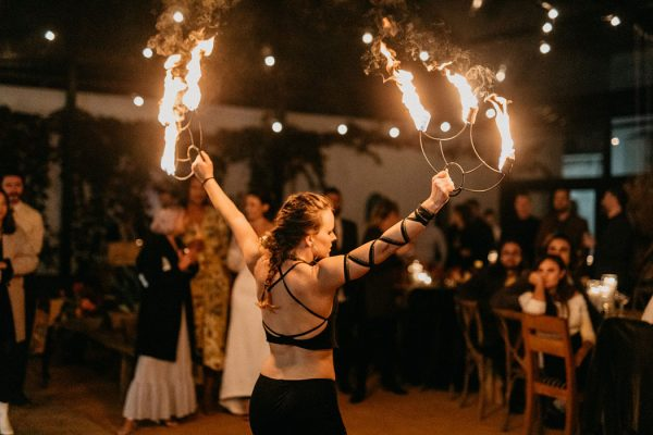 Toni Thord- Gray fire dancing with FireTribe's 3 wick fire fans at a wedding