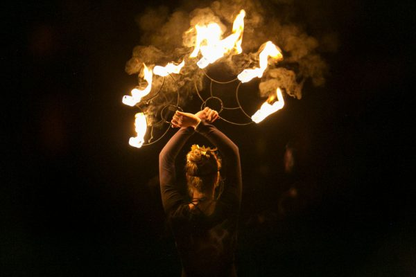 A fire dancer from firetribe is the entertainment at a wedding in cape town